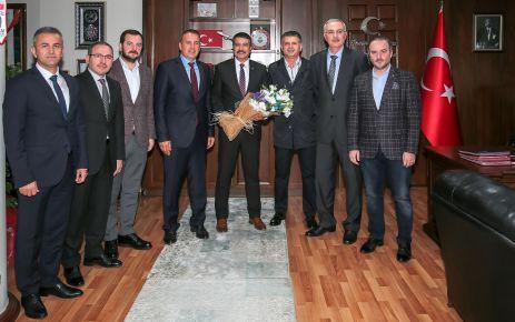 Arsin OSB'den Müdür Metin Alper'e Hoş geldin ziyareti