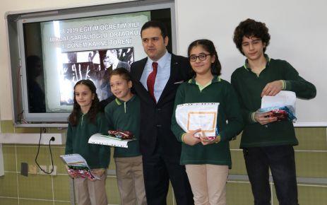Kaymakam Fırat ve Başkan Sarıalioğlu'ndan öğrencilere karne
