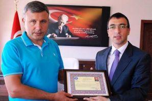 Arslan'dan Yüzbaşı Coşkun'a Başarı Belgesi