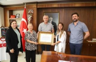 Mikdat Sarıalioğlu'na Üstün Hizmet Beratı